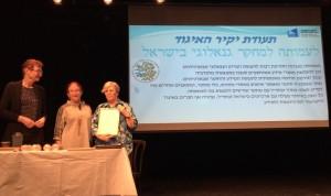 Rosie receiving award